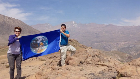 Armando Azua-Bustos and Jen Blank in Chile with the Blue Marble flag